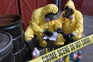 two people in yellow haz-mat suits at a meth lab